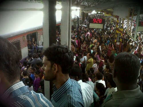 crowded mumbai local train station